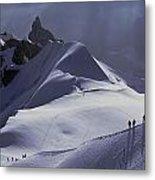 Hikers Follow Paths Across The Snow Metal Print