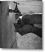 Hispanic Man Cupping Water And Washing Hands At Outdoor Tap Metal Print by Joe Fox