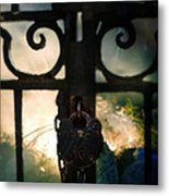 Hooded Figure By A Fire Metal Print