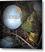 Hubcaps And Oil Cans Metal Print by Steve McKinzie