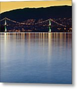Illuminated Bridge Across A Bay Metal Print by Bryan Mullennix