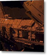 In The Darkness Of Space, An Astronaut Metal Print by Stocktrek Images
