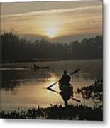 Kayakers Paddle Through Still Water Metal Print