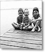 Kids Sitting On Dock Metal Print