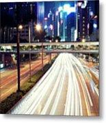 Light Trails At Traffic On Street At Night Metal Print