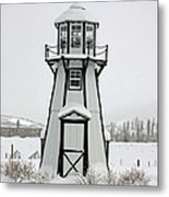 Lighthouse In The Snow Metal Print