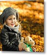 Little Girl In Autumn Leaves Metal Print