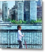 Little Girl On Scooter By Manhattan Skyline Metal Print