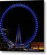 London Eye All Done Up In Blue Light In The Night With A Small Reflection In The Thames Metal Print