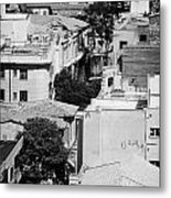 looking down over rooftops to ledra street crossing and  restricted area of the UN buffer zone  Metal Print