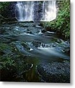 Low Angle View Of A Waterfall Metal Print
