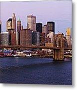 Lower Manhattan Skyline And Brooklyn Bridge At Dawn Metal Print