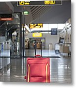 Luggage Sitting Alone In An Airport Terminal Metal Print
