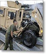Marine Uses A Pressure Washer To Clean Metal Print