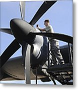 Mechanic Finishes Moving An Engine Metal Print