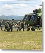 Medical Personnel Carry A Wounded Metal Print