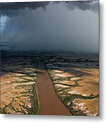 Monsoon Rains Over A Muddy River Metal Print by Randy Olson
