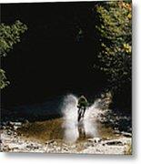 Mountain Biker Splashing Through Water Metal Print