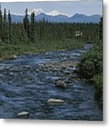 Mountain Stream With Cabin In Evergreen Metal Print