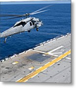 N Mh-60s Sea Hawk Helicopter Lifts Metal Print