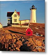 Nubble Light Sunset Metal Print by Catherine Reusch Daley