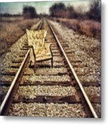 Old Chair On Railroad Tracks Metal Print