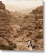 People Walk Along A Path Metal Print by Taylor S. Kennedy