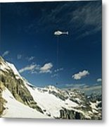 Person Dangles From A Helicopter Metal Print by Michael Melford