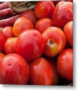 Pile Of Red Luscious Tomatoes Along With Carrots On A Vegetable Basket Metal Print