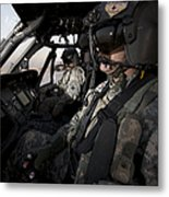 Pilot In The Cockpit Of A Uh-60l Metal Print