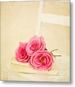 Pink Roses Laying On A Book Metal Print
