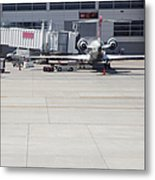 Plane At Gate Metal Print by Shannon Fagan