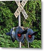 Railroad Crossing Light And Greenery Metal Print