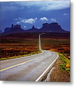 Rainclouds Over Monument Valley Metal Print
