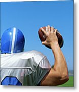 Rear View Of A Football Player Throwing A Football Metal Print