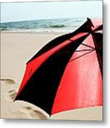 Red And Black Umbrella On The Beach With Footprints Metal Print