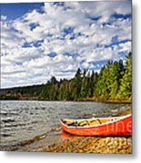 Red Canoe On Lake Shore Metal Print