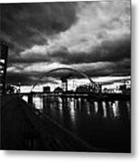 riverside walkway by the Clyde Arc bridge over the river clyde at dusk in Glasgow Scotland UK Metal Print