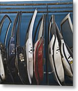 Row Of Dismantled Car Doors Metal Print by Noam Armonn