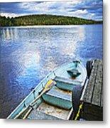 Rowboat Docked On Lake Metal Print