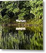Rowboat Moored On The Bank Of A Lake Metal Print