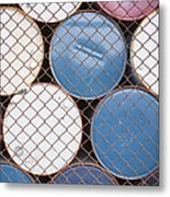 Rows Of Stacked Barrels Behind A Fence Metal Print