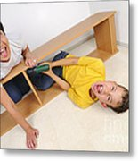 Screaming Mother And Son Assembling Furniture Metal Print