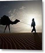 Silhouette Of Berber Leading Camel Metal Print