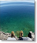 Sitting On A Cliff Metal Print