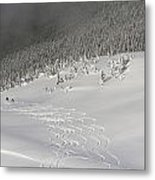Skiers At The Base Of A Mountain Metal Print