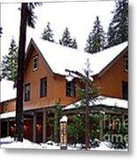 Snow Atop The Inn At Longmire Metal Print by Kathy  White