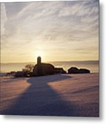 Snow Covered Field With Farm Silhouette At Sunset Metal Print by Jeremy Woodhouse