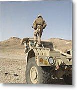 Soldier Climbs A Damaged Husky Tactical Metal Print by Stocktrek Images