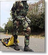 Soldier Drags A Simulated Attack Victim Metal Print